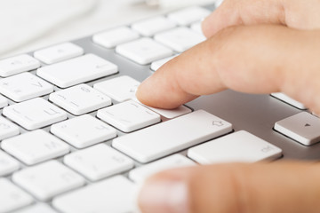 Woman Hand pushing keyboard button