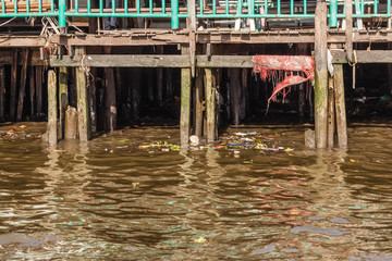 Stilts and polluted water