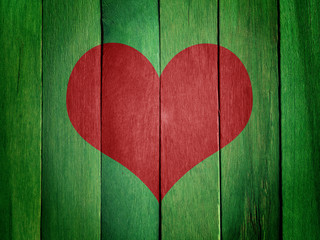 Heart on Green Wood Background