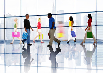 Group of People Walking in a Shopping Mall