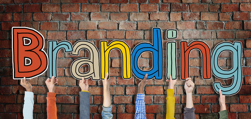 Multiethnic Group of Hands Holding Word Branding