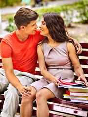 Couple student with book outdoor.
