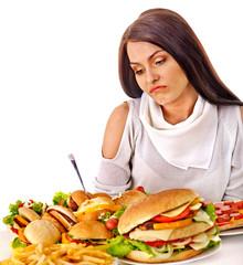Woman holding hamburger.