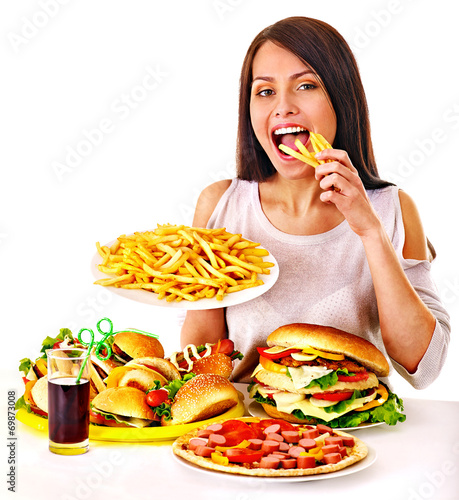 canvas print picture Woman eating fast food.