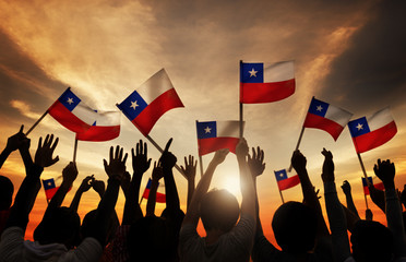 Silhouettes of People Holding Flag of Chile