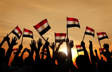 Silhouettes of People Holding the Flag of Egypt