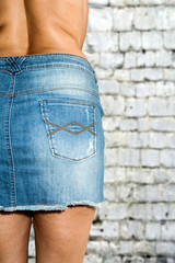 Woman with skirt jeans topless