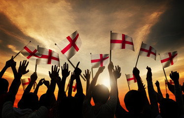Silhouettes of People Holding Flag of England