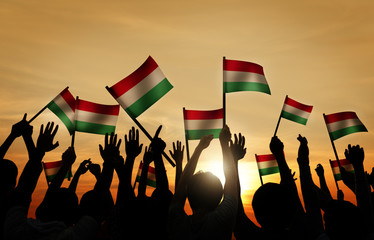 Silhouettes of People Holding the Flag of Hungary