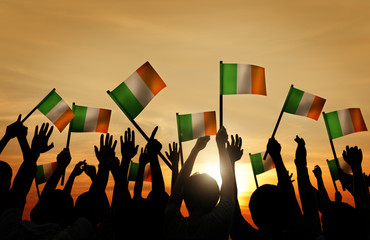 Silhouettes of People Waving the Flag of Ireland