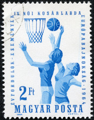 stamp printed in Hungary shows image of netball players