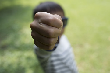 Boy shows his fist