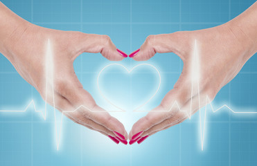 Female hand showing heart shape gesture