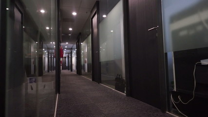 Dolly video of a dark empty office