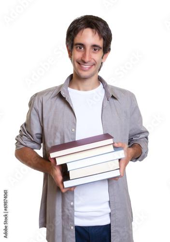 canvas print picture Mann mit schwarzen Haaren kommt aus der Bücherei