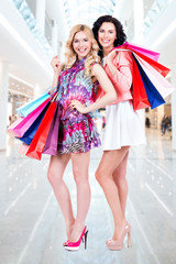 Attractive woman with multicolor shopping bags.