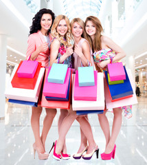 Happy young group of women  after shopping in the big mall