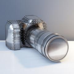 Conceptual Metal (Platinum) Photo Camera On White Desk