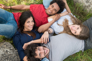 Group Of Friends Lying On Grass