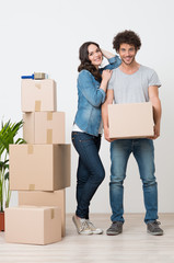 Couple Standing Near Stack Of Boxes