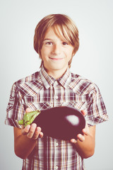 child with fresh eggplant