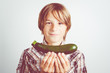 child with fresh zucchini