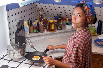 Woman to cook in the kitchen