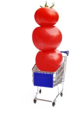 Shopping cart with three tomatoes in balance