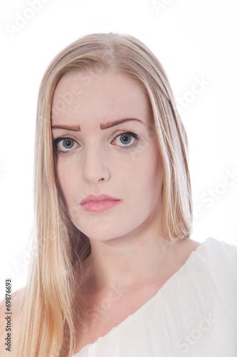 canvas print picture Close-Up Portrait of Serious Blond Woman