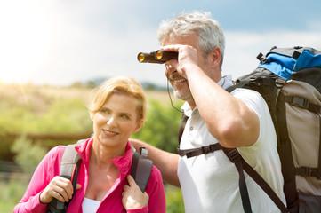 Mature Hikers With Binocular