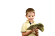smiling boy looking at a stack of 100 US dollars bills