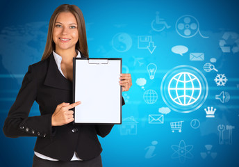 Businesswoman with cloud icons and world map