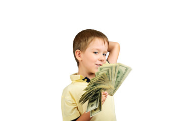 smiling boy looking at a stack of 100 US dollars bills and think