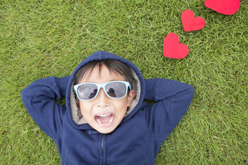 Boy lying with red hearts