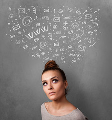 Young woman thinking with social network icons above her head