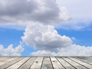 Paving wood floor with cloud and blue sky