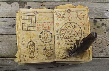 Magic book on wooden table 1