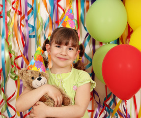 happy little girl with teddy bear birthday party
