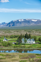 Scenic view of famous Thingvellir with white church, Iceland.