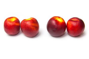 .Nectarines isolated on a white studio background.