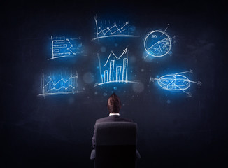 Businessman in chair looking at charts