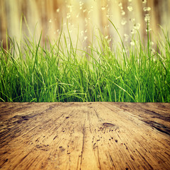 old wood table and grass background