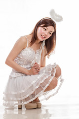 Beautiful Asian Woman in Angel Costume, sitting looking down