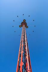 Flying swing carousel against blue sky