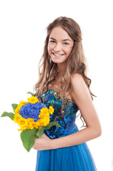 Happy smiling female model with a bouquet of flowers.