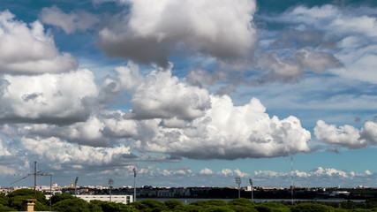 Beautiful Cumulus Clouds over Town, timelapse