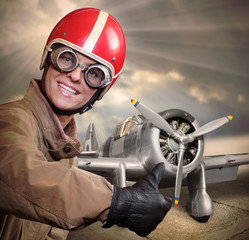 Happy pilot with retro aircraft.
