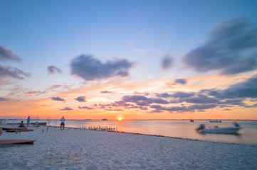 sunset on tropical beach in Isla Mujeres, Mexico