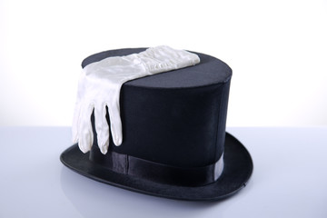 Black top hat with silk white gloves