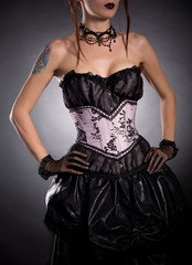 Elegant woman in corset with floral pattern